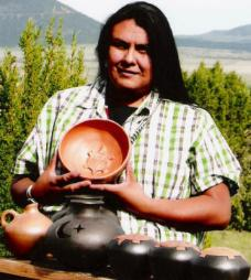 Apache woman with her handmade pottery