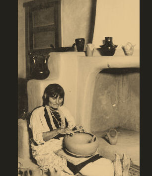 Navajo woman with her handmade pottery