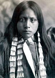 Apache wearing a bone necklace, 1920