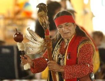 Apache Indian Performing Music Using Handmade Gourd Instruments