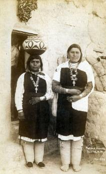 Zuni women with their pottery, 1930.
